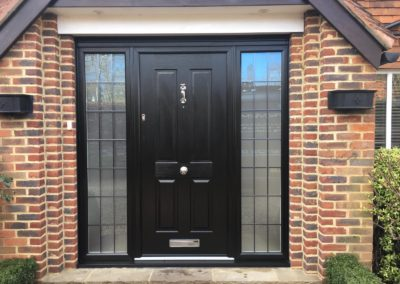 Black Solidor Composite Front Door With Lead In Side Panels