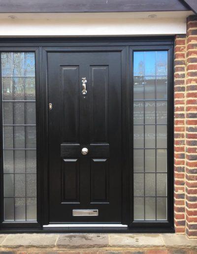Black Solidor Composite Front Door With Lead In Side Panels