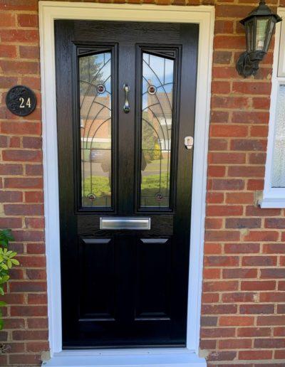 Black Front Door With Detailed Glass