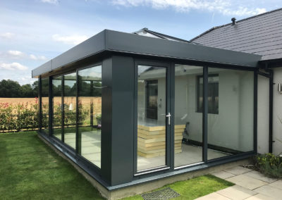 Grey Box Conservatory With Lantern Roof