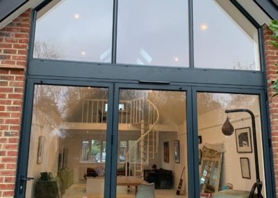 Grey Bi Fold Doors With Gable Window