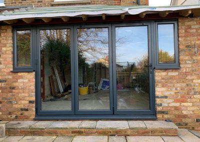 Grey Bi Folding Doors With Side Panels